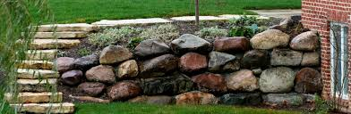 retaining wall with glacial granite boulders