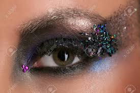 woman s eye with makeup and colorful crystals s eye eyeshadow and colorful crystals