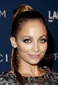 Nicole Richie goes make up free as she heads out in plunging maxi dress  during family holiday