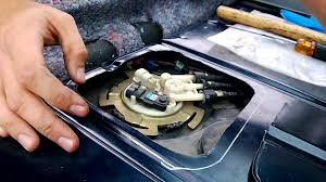 Cutting Fuel Pump Access Panel and Removing Fuel Pump Assembly ...