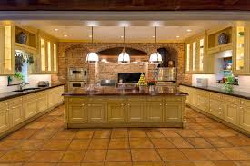 spacious kitchen with maple cabinets and porcelain floor tile