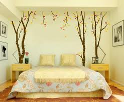 bedroom with lavish furniture of bed between wooden dressers plus alluring wall decoration ideas with fairy room decor theme of tree sticker in autumn