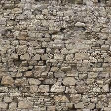 seamless texture of meval stone wall consisting of grey stones of various shapes and sizes