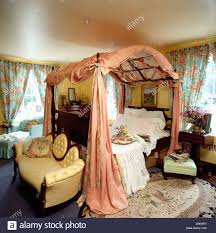 Peach Bedroom Peach Silk Drapes On Four Poster Bed With Arched Top In Country