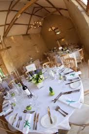 main barn wedding reception with round top table