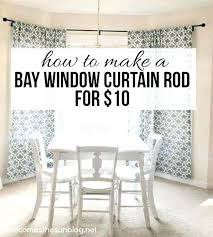 where to hang curtains on a window hanging eyelet curtains bay window