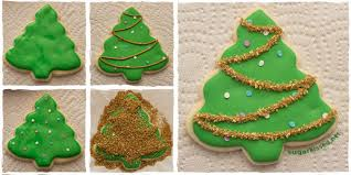After you have baked your sugar cookies in the shape of Christmas trees and  let them cool completely, begin decorating by outlining the edge of a cookie  ...