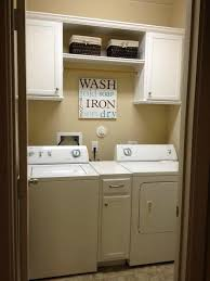Laundry room - remove the ugly wire shelf and replace w basic white cabinets  for a