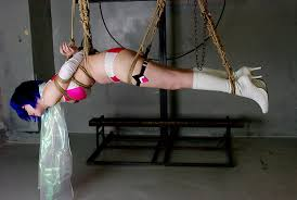 Bondage and suspension in boots