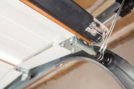 once you ve located the bypass trigger yank it down and pull it back toward the garage door opener motor this will keep the door up while you either pull