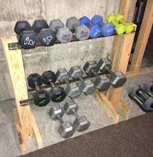 decoration dumbbell rack i made this from s lumber and the iron rails are diy