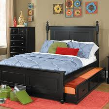 black wooden trundle bed with white blue and orange bedding set feat high head board placed