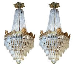 a pair of empire style six light chandeliers copper decorated with cut glass