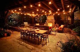 charming patio pergola lighting ideas featuring mason fireplace and outdoor dining and living furniture set