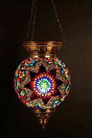 moroccan inspired lighting. we love the vibrant spectrum hues and copper frame of this moroccan inspired hanging lantern u2013 intricate glass mosaic metalwork make it truly lighting