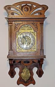 gustav becker a large art nouveau wall clock with gilt metal pendulum cast as a