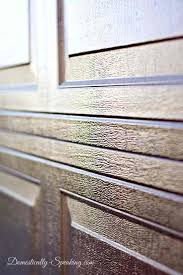 stained garage doors close up of gel stained garage door one year later faux wood stained