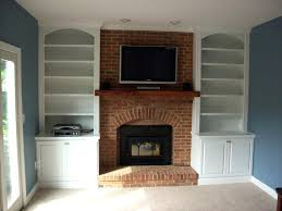 wooden mantel over brick fireplace brown shelf added double white bookshelves blue wood mantels