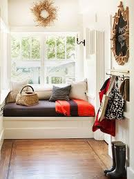 I LOVE this big built in cozy bench nook Fixed and Hidden Storage --laundry  room/mudroom/entry/reading nook --add lots of storage and a bathroom  entrance