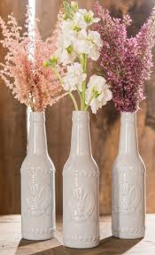 A centerpiece for any event: Ceramic bottle vases with flowers. My Big Day  Events  Wedding LavenderDiy ...