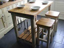 block kitchen island with breakfast bar little ideas cart rolling dishwasher kitchens auckland ikea trolley cabinet trends led pendant lights elegant
