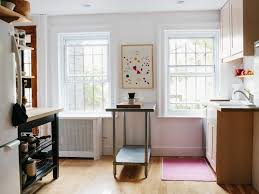 do you have a smallish kitchen or maybe you re on the fence about work islands think they re too suburban here are a dozen low commitment