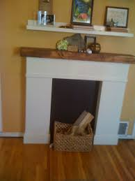 furniture white fireplace surround with brown wooden shelf above placed on the yellow wall and