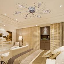 recessed lighting combined with ceiling fan with chandelier and striped bedding for modern bedroom decoration with