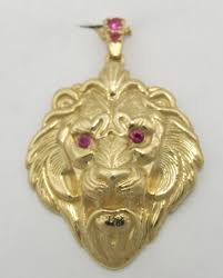 14k yellow gold lion head with ruby eyes and bale pendant