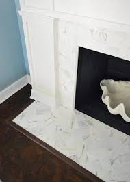some of you were curious about how we concealed the exposed edge of the cement board around the firebox we just used a piece of trim that we had in our