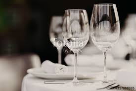 dinner table background. Indoor Shot Of Empty Glasses On Festive Dinner Table With White Tablecloth Against Dark Blurred Background C
