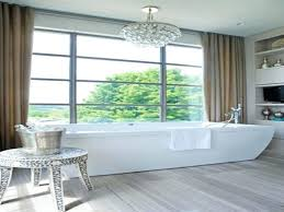 desirable chandelier over bathtub plus chandelier over dining table
