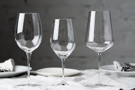 three diffe wine glasses on a table