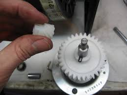 once you get that clip off and slide off the little white gear you can lift the whole chain sprocket and the shaft with the stripped white gear out the