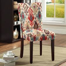 Dining Chairs: A Beautiful Multi Colored Ikat Pattern Decorates The Fabric  Upholstery Of These Parson