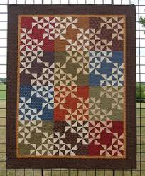 """Quilt for Sale, """"Pottery Shards"""" is a small quilt made with Civil ... & Handmade Quilt for Sale, """"Pinwheel Puzzle"""" is a lap size quilt made with Adamdwight.com"""