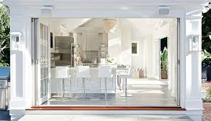 pool house kitchen. Pool House Features Folding Doors Opening Up To Kitchen With White Base Cabinets Topped Speckled Countertops And No Top Cabinets. O