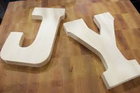 wood letters from hobby lobby diy paper covered wood letters the everyday home blog