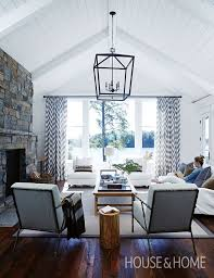 design ideas betty marketing paris themed living: in this cottage living room a vaulted ceiling and shiplap walls create a light filled and tranquil space photographer angus fergusson designer