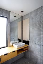 Image unique bathroom Unusual Unique Bathroom Design Interior With Mosaic Grey Wall And Floor Design Decorated With Yellow Bathroom Vanity Furniture For Inspiration Bathroom Hero Architecture Unique Bathroom Design Interior With Mosaic Grey Wall