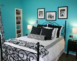 traditional style bedroom with black white accent bedding design turquoise wall paint in blue