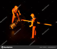 concept collective solution problem miniature toy engineers solve technological problems stock photo