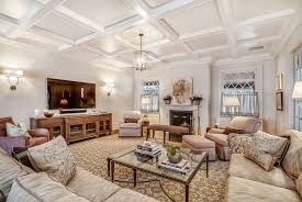traditional family room with hardwood floors by sunrise building family room chandelier ideas