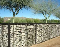 BELOW ARE EXAMPLE PHOTOS OF GABION FENCES - NOTE THE ADDED WOOD FEATURES