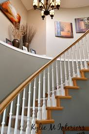 how high to hang a light fixture chandelier or fan in a foyer or entryway with an open stairwell or stairway