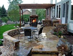 outdoor patio designs breathtaking with classic stone fireplace and kitchen plus dining area using round black t74 designs