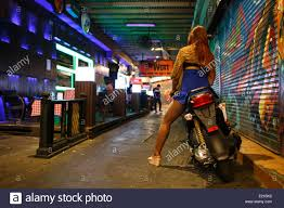 Outside Bar A Young Thai Woman On A Motorbike Outside Bar In Alley At Night