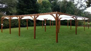 the 10 x 20 wood shade structures have the flexibility to be installed together to create up to a 40 x 60 structure natural fabric top ds and side