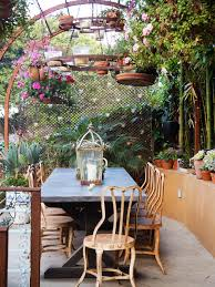 2 hanging flower pots on an old iron tower to enhance your porch