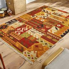 kilim rug on wooden flooring with chair on frame of image the rug er